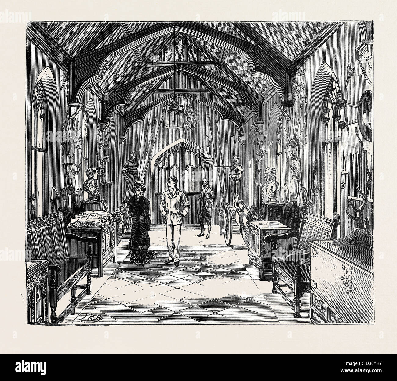 THE EMPRESS OF AUSTRIA AT COMBERMERE, CHESHIRE: THE ARMOURY IN THE ENTRANCE HALL - Stock Image