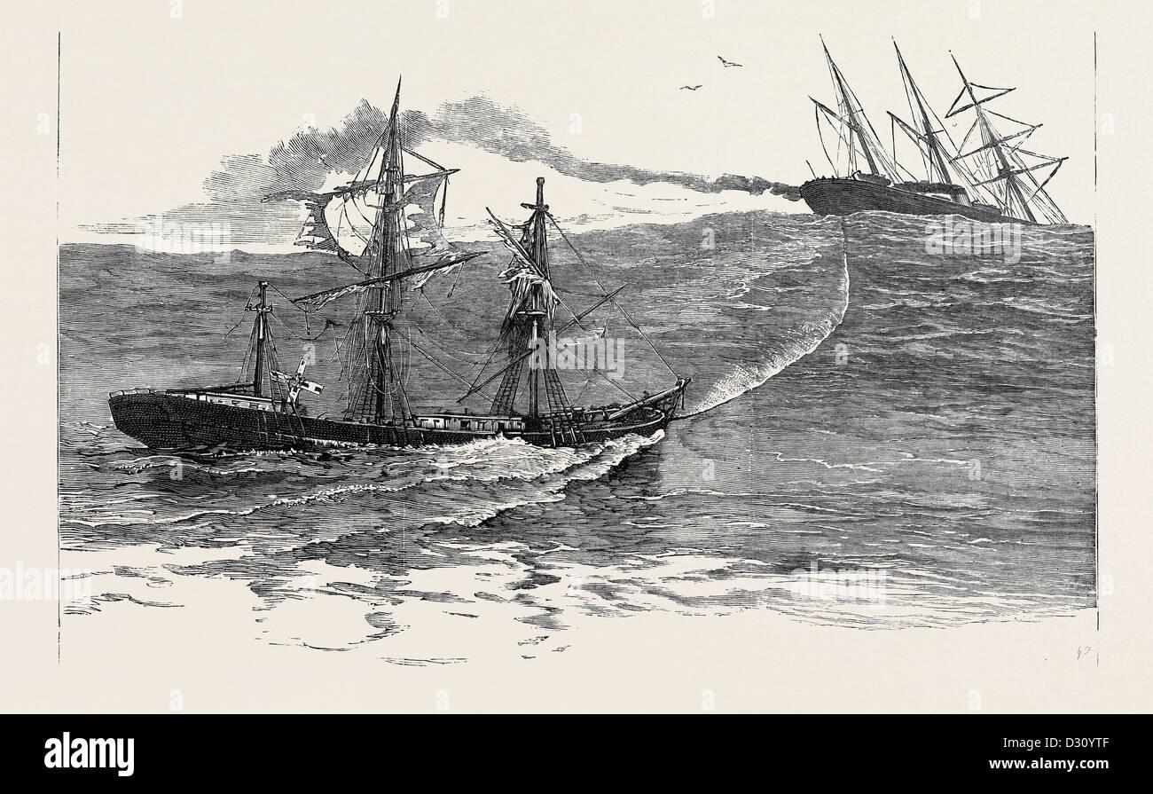 A DISASTER AT SEA: THE S.S. 'PALMYRA' TOWING THE DERELICT BARQUE 'NORTON' TOWARDS FALMOUTH - Stock Image