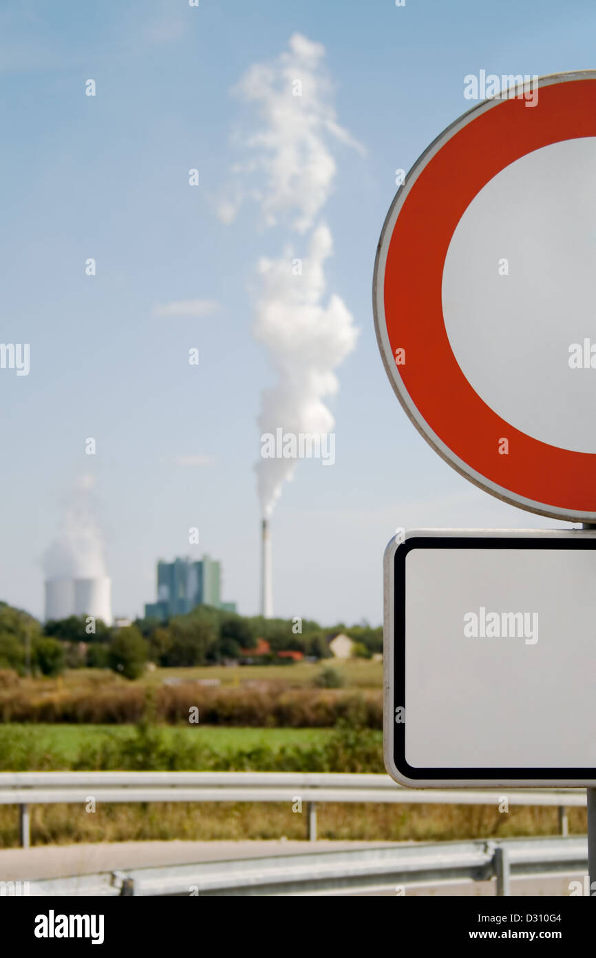 in focus -No Traffic Red Road Sign. Out of focus - industrial building - Stock Image