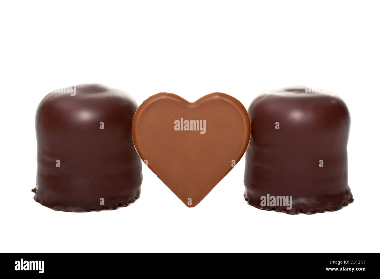 two funny marshmallows with chocolate heart - Stock Image