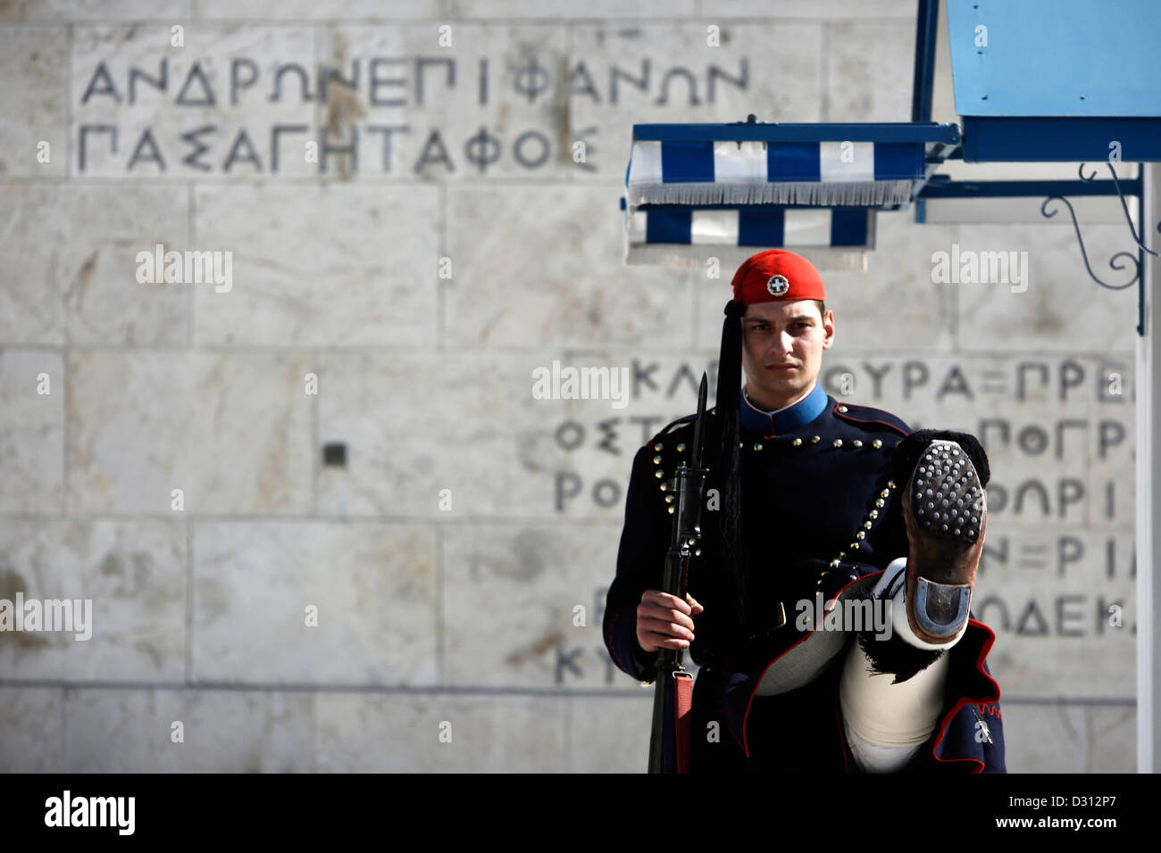Guard (Evzone) marching in front of the Tomb of the Unknown Soldier, Athens, Greece. - Stock Image
