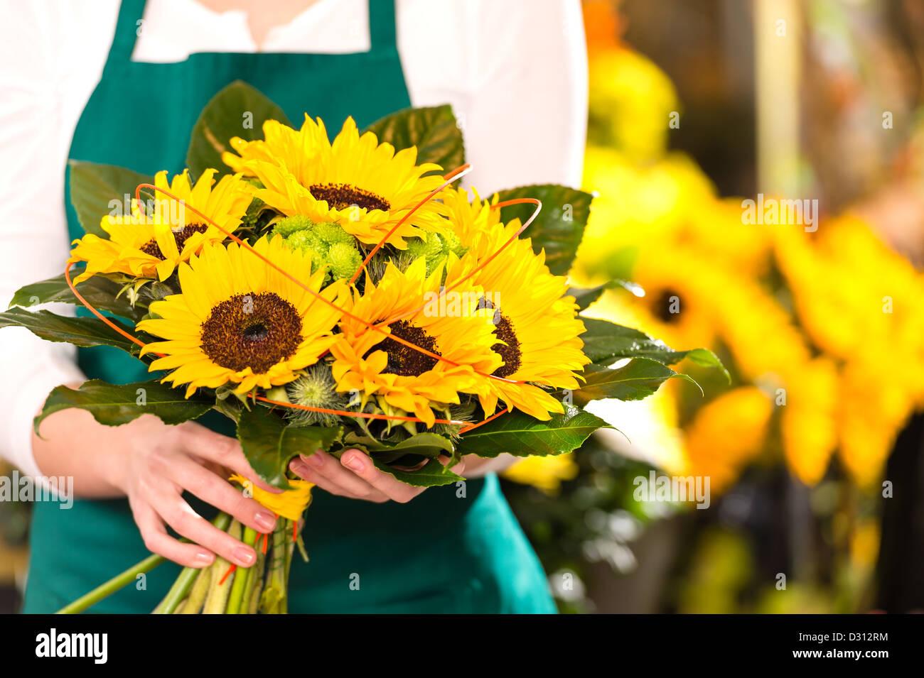 Bouquet sunflowers flower shop female florist holding - Stock Image