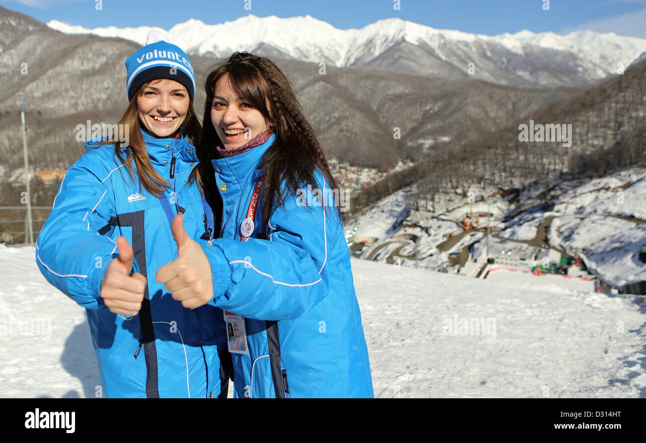 Volunteers pose during the FIS Nordic Combined World Cup at the skiing area RusSki in Krasnaya Polyana near Sochi, - Stock Image