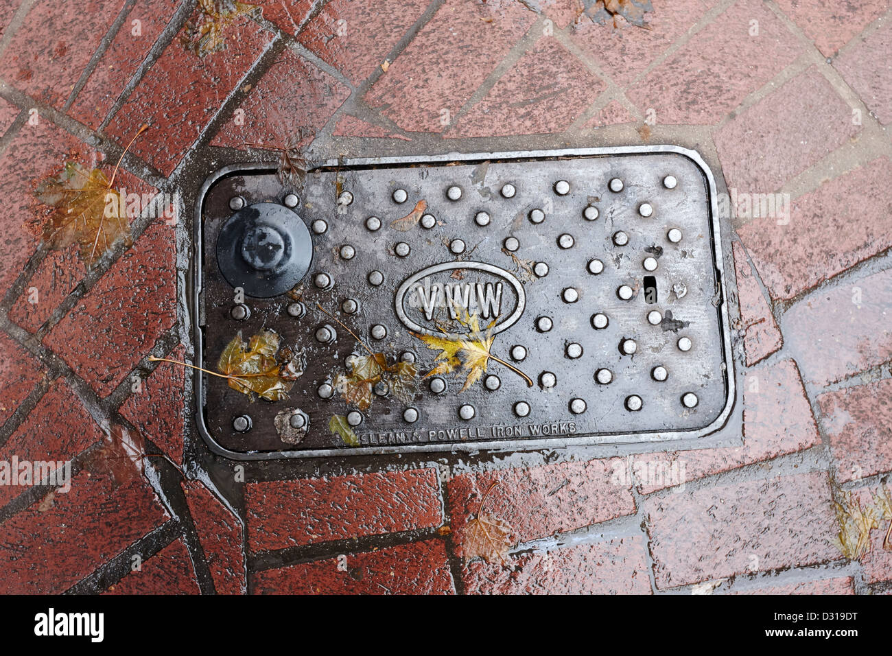 Vancouver water works street drainage access plate made by mclean and powell iron works BC Canada - Stock Image