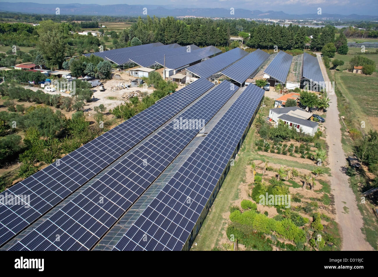 Aerial view of solar panels on commercial agricultural greenhouses, Roquebrune-sur-Argens, Var region, France - Stock Image