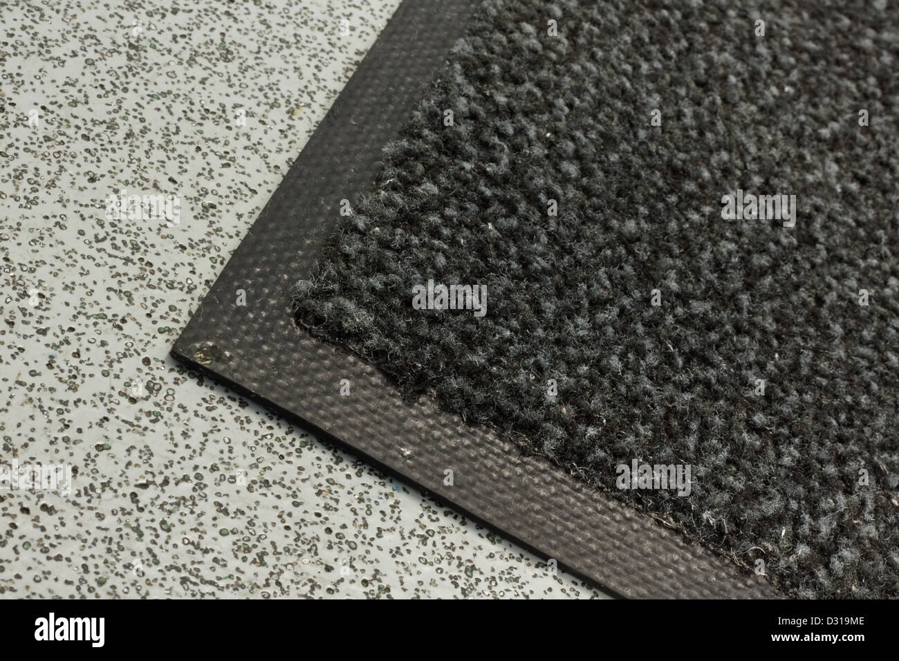 Industrial dust mat used in offices and warehouses or any commercial building - Stock Image