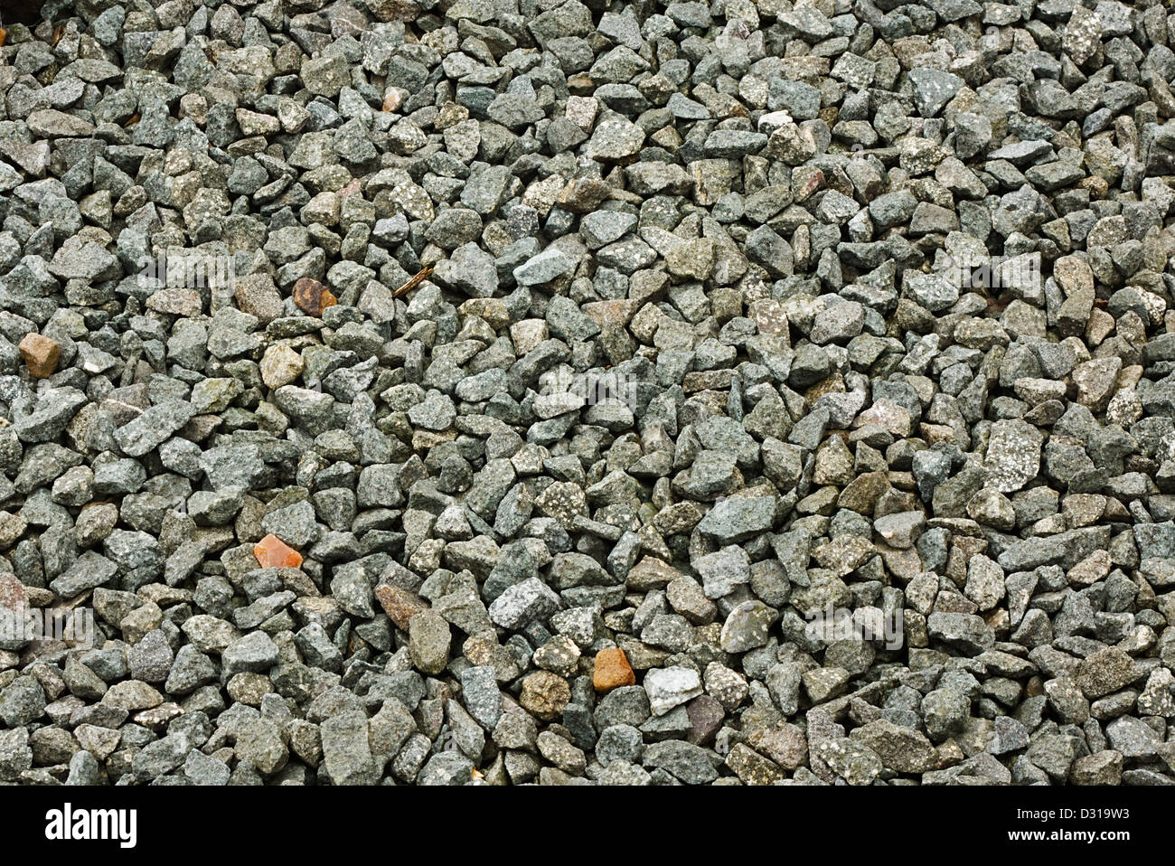 granite stone decorative chippings or aggregates used on driveways and walkways - Stock Image