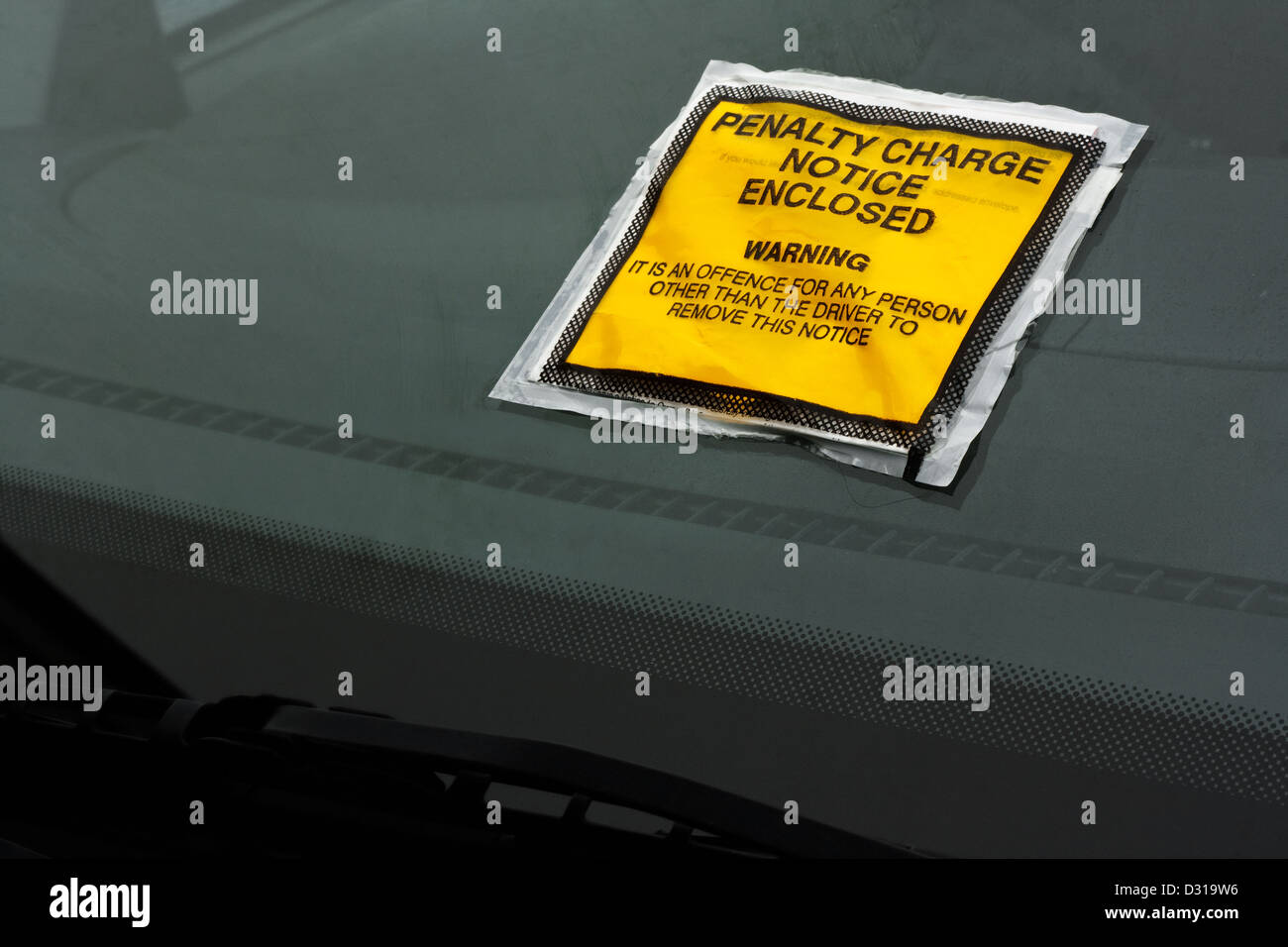 Parking ticket stuck on car windscreen a penalty or fine - Stock Image