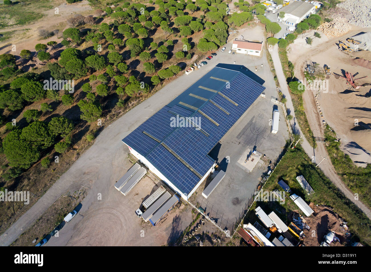 Solar panels on warehouse, aerial view, France, Europe - Stock Image