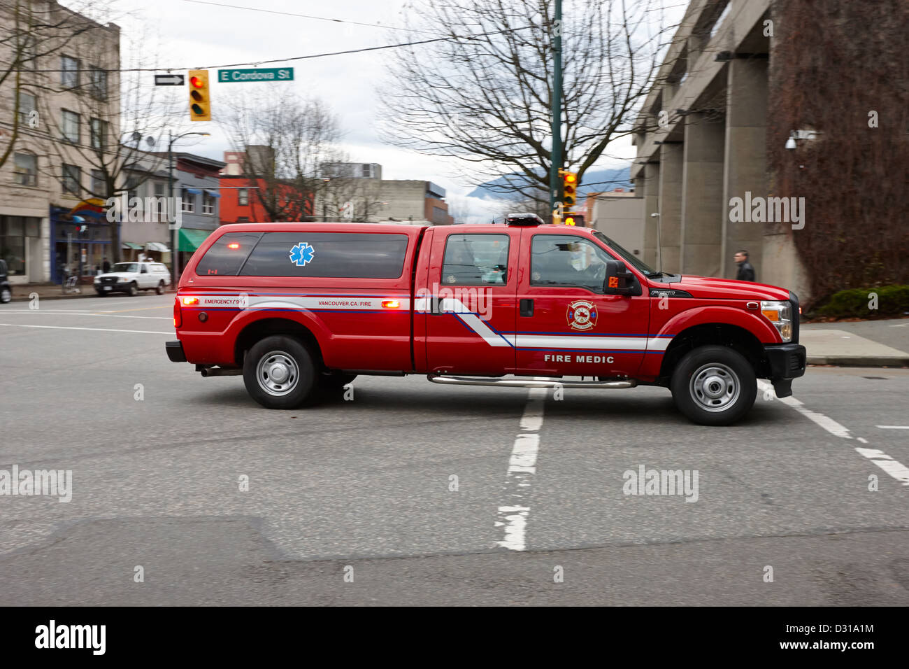 Vancouver fire rescue services medic fast response vehicle speeding through downtown eastside BC Canada - Stock Image