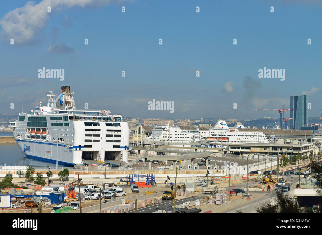 Ferries at quay at Marseille's harbor, with the Tour Mediterranee on the right, Marseille, France - Stock Image
