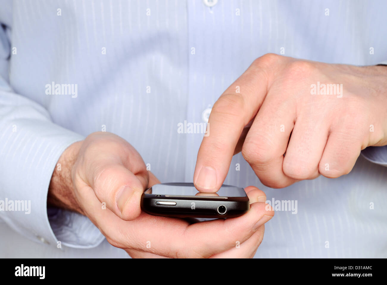 Man Using a Smartphone, Close Up. - Stock Image