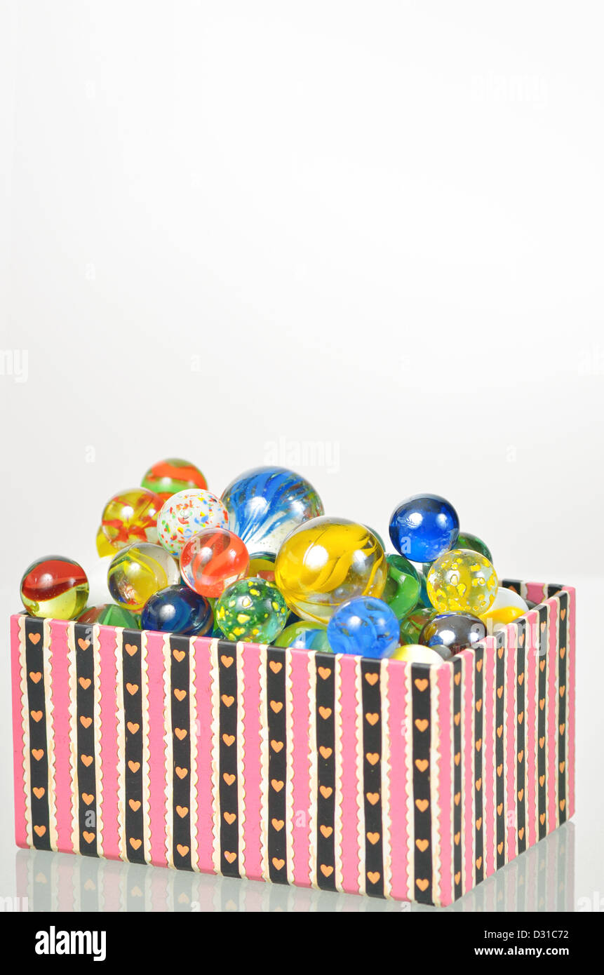 marbles balls in box - Stock Image