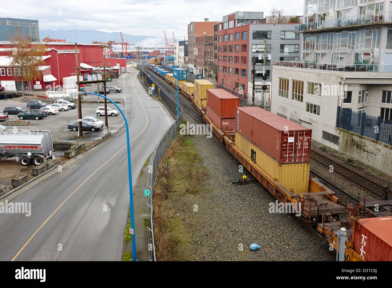 freight train goods tracks near main street and port metro docks Vancouver BC Canada - Stock Image