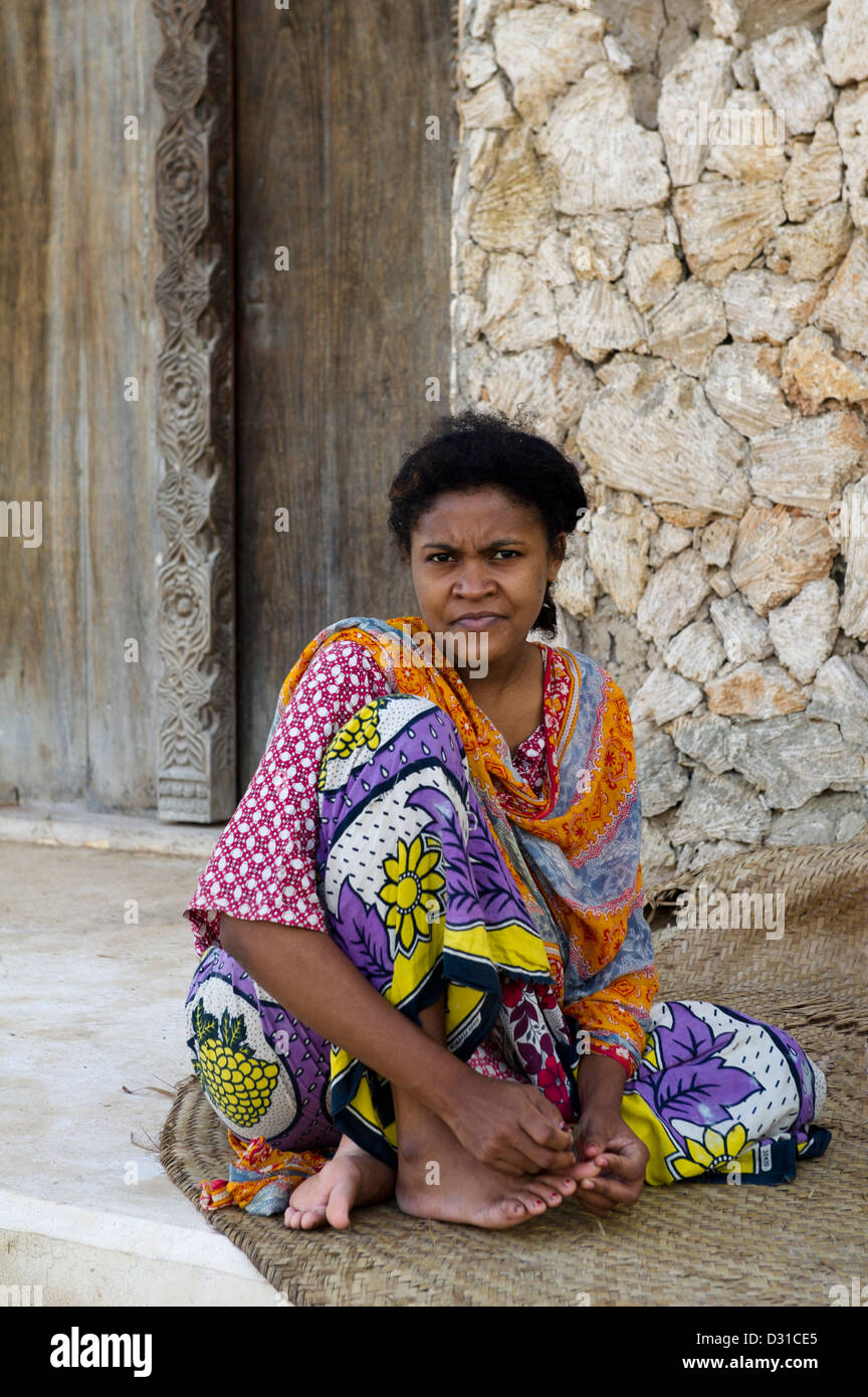 Woman sitting outside her house, Lamu, Lamu Archipelago, Kenya Stock Photo