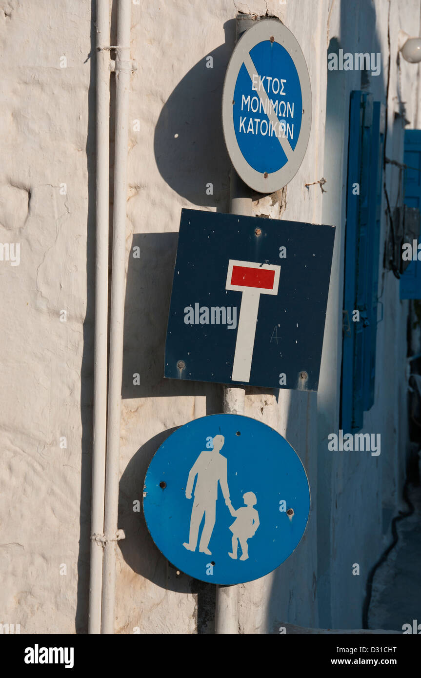 Three blue Greek road signs, pedestrians, no through road and no entry on a street corner. - Stock Image