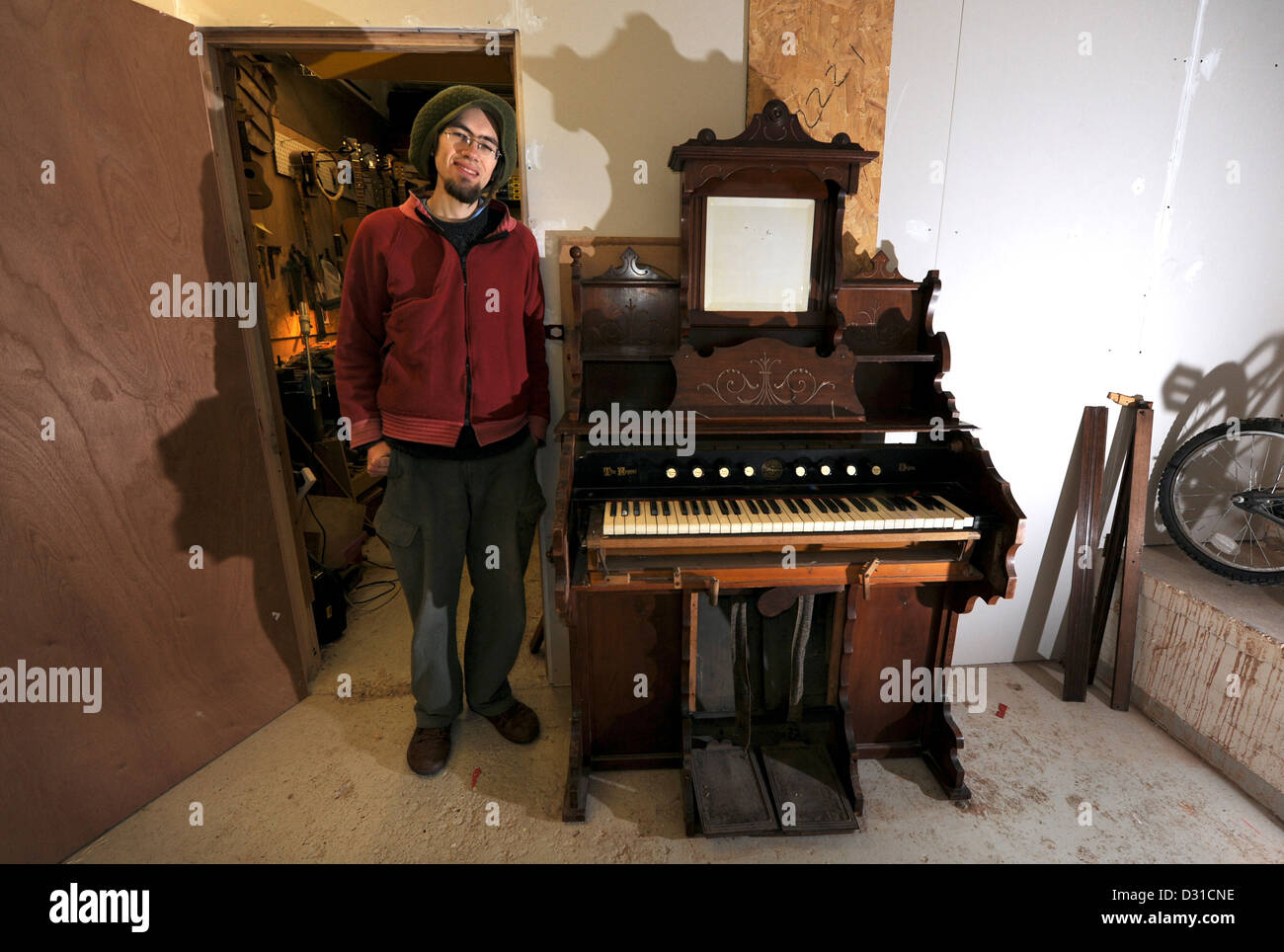 Tim Lloyd has an old Victorian pump organ which he is trying to find a new home for - Stock Image