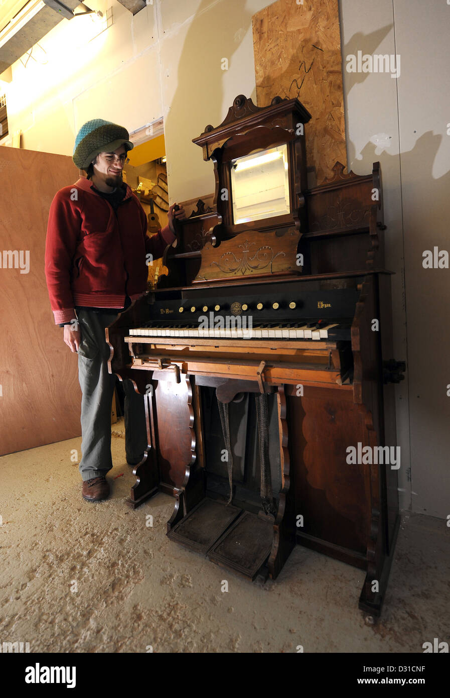An old Victorian pump organ made by William Sames Ltd - Stock Image