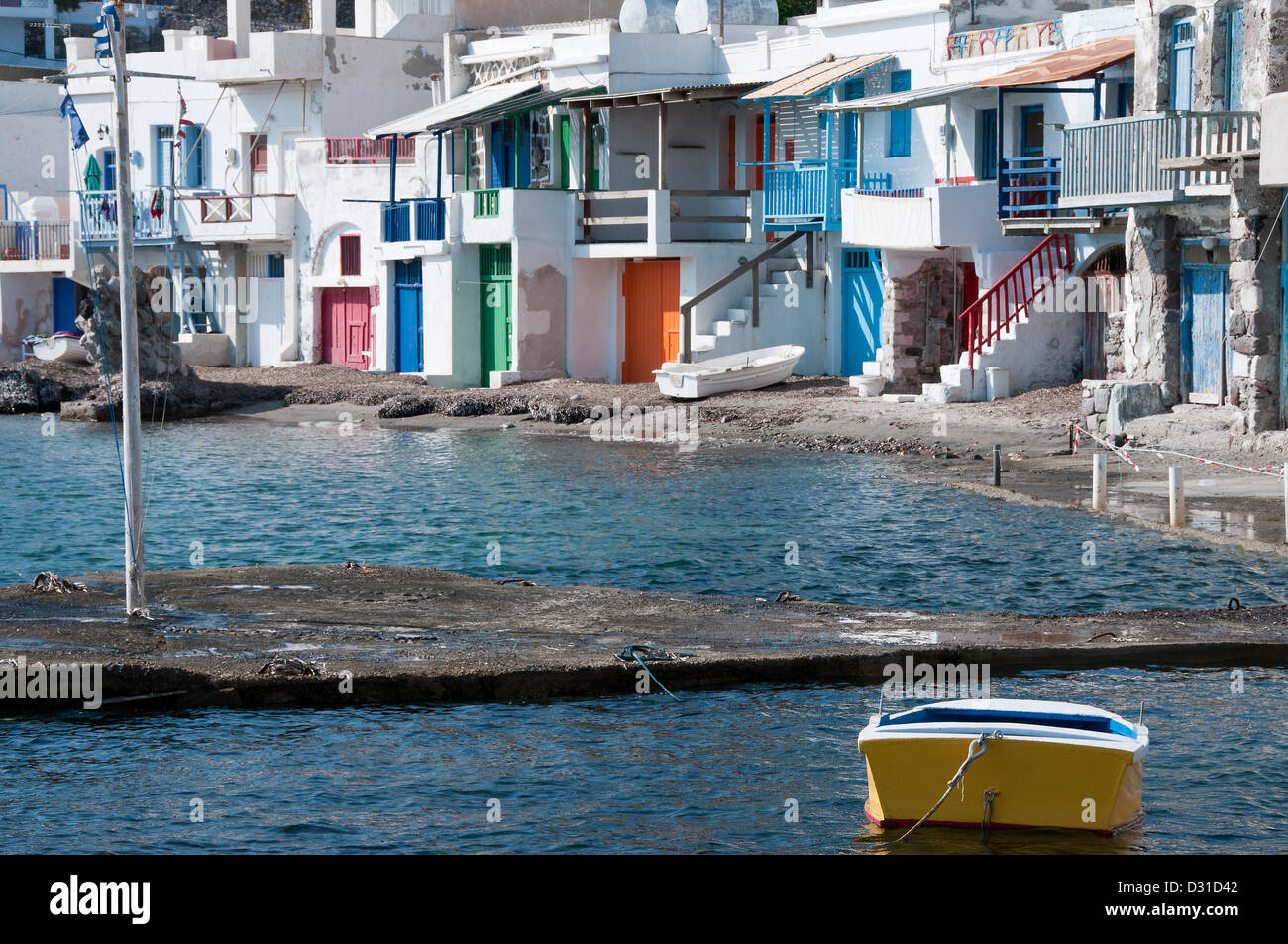 Klima, a traditional beach front village in Milos, Greece.  The houses, 'syrmata' are carved out the rock. - Stock Image