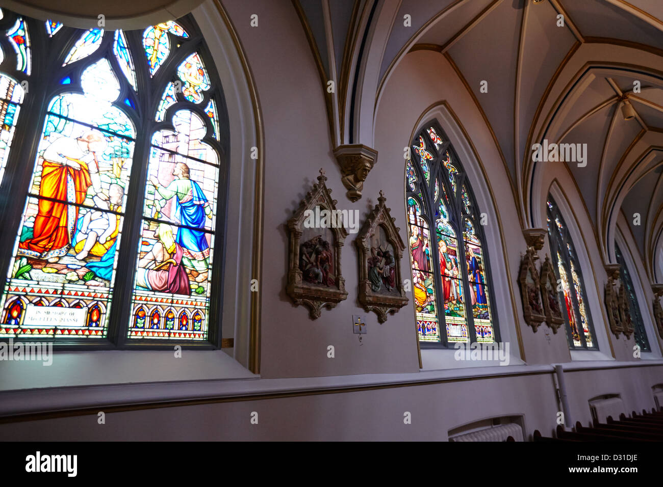 stained glass windows and stations of the cross interior of holy rosary cathedral Vancouver BC Canada - Stock Image