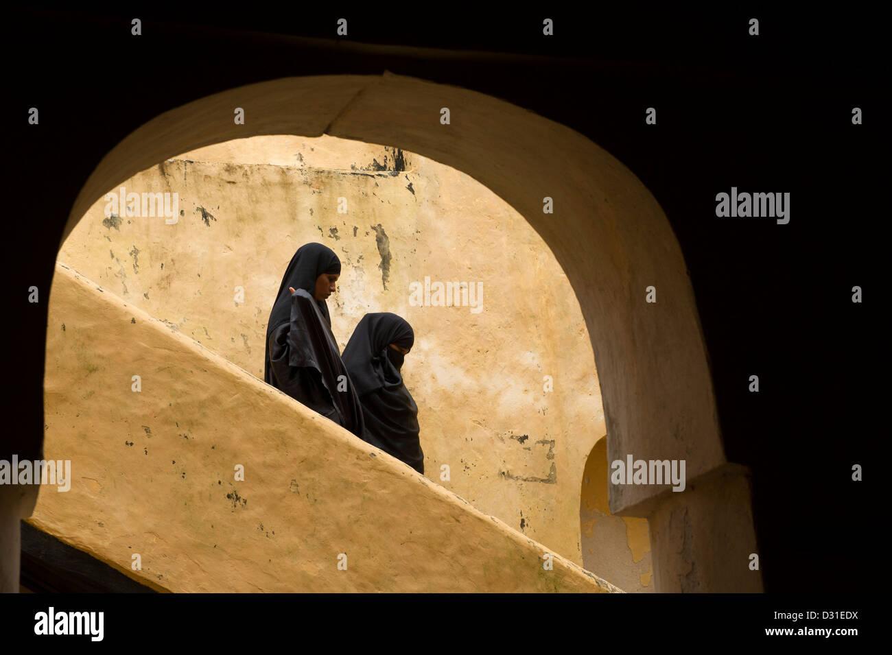 Muslim women in the old fort, Lamu, Lamu Archipelago, Kenya - Stock Image