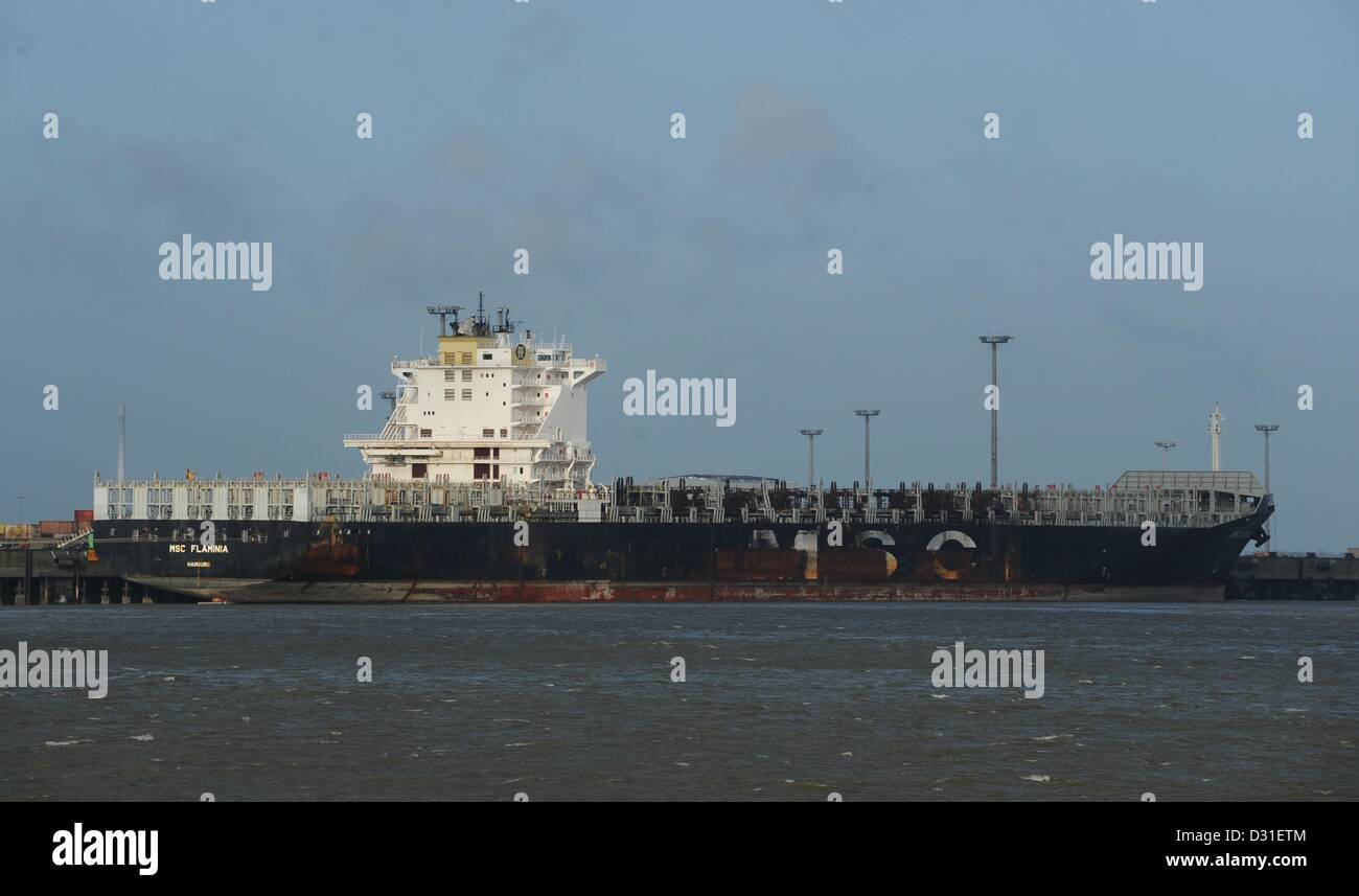 The ship 'Flaminia' is situated in the Jade-Weser Port in Wilhelmshaven, Germany, 04 February 2013. The departure of the burned out container ship keeps being delayed. The NSB shipping company in Buxtehude was planning to bring the ship to a shipyard in Romania. Photo: Carmen Jaspersen Stock Photo