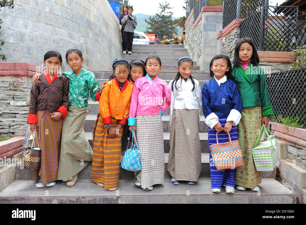 Group of young girls in National costume on their way to school in Thimphu, Bhutan - Stock Image