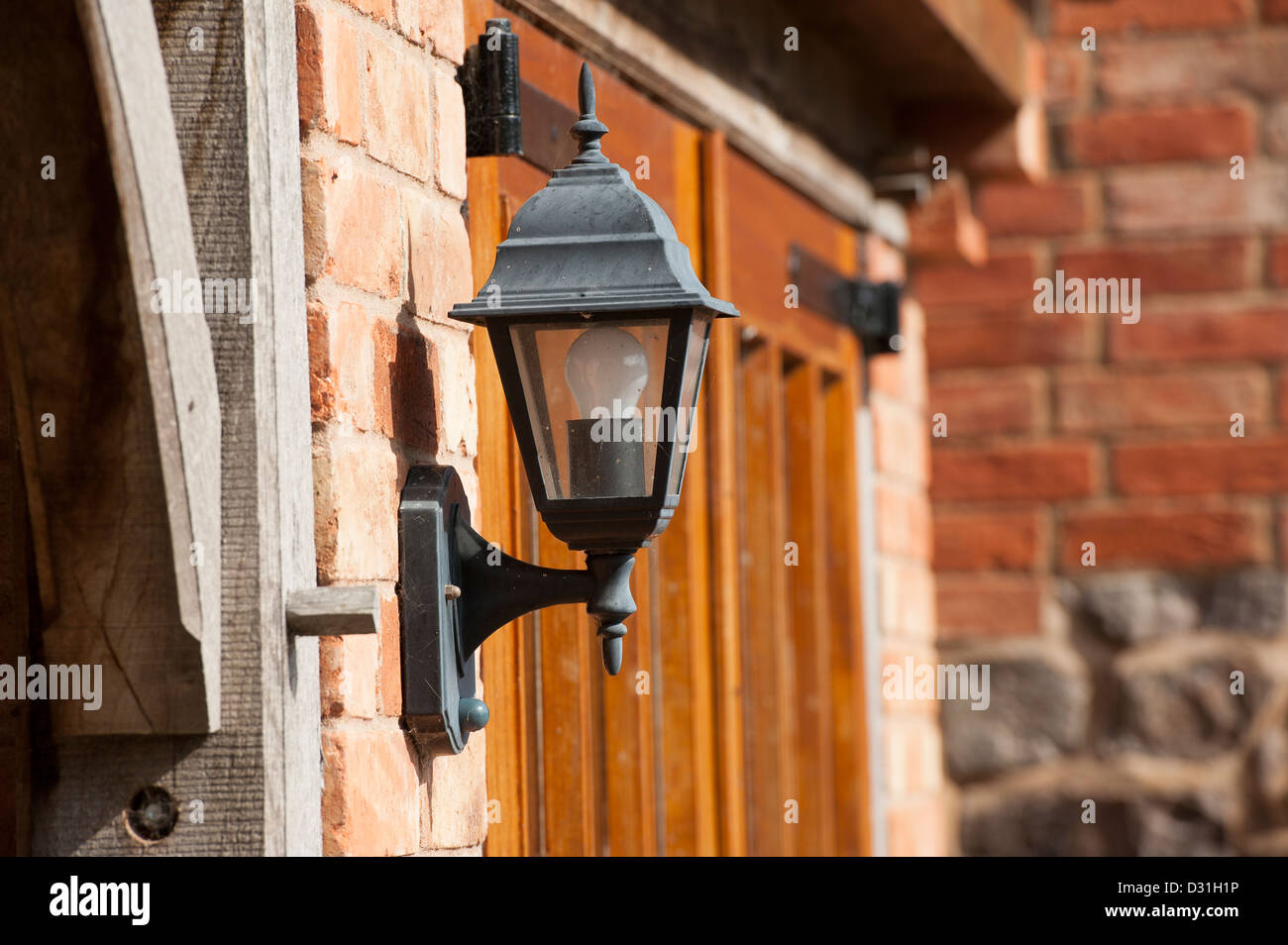 Lamp outside the entrance to a house. - Stock Image
