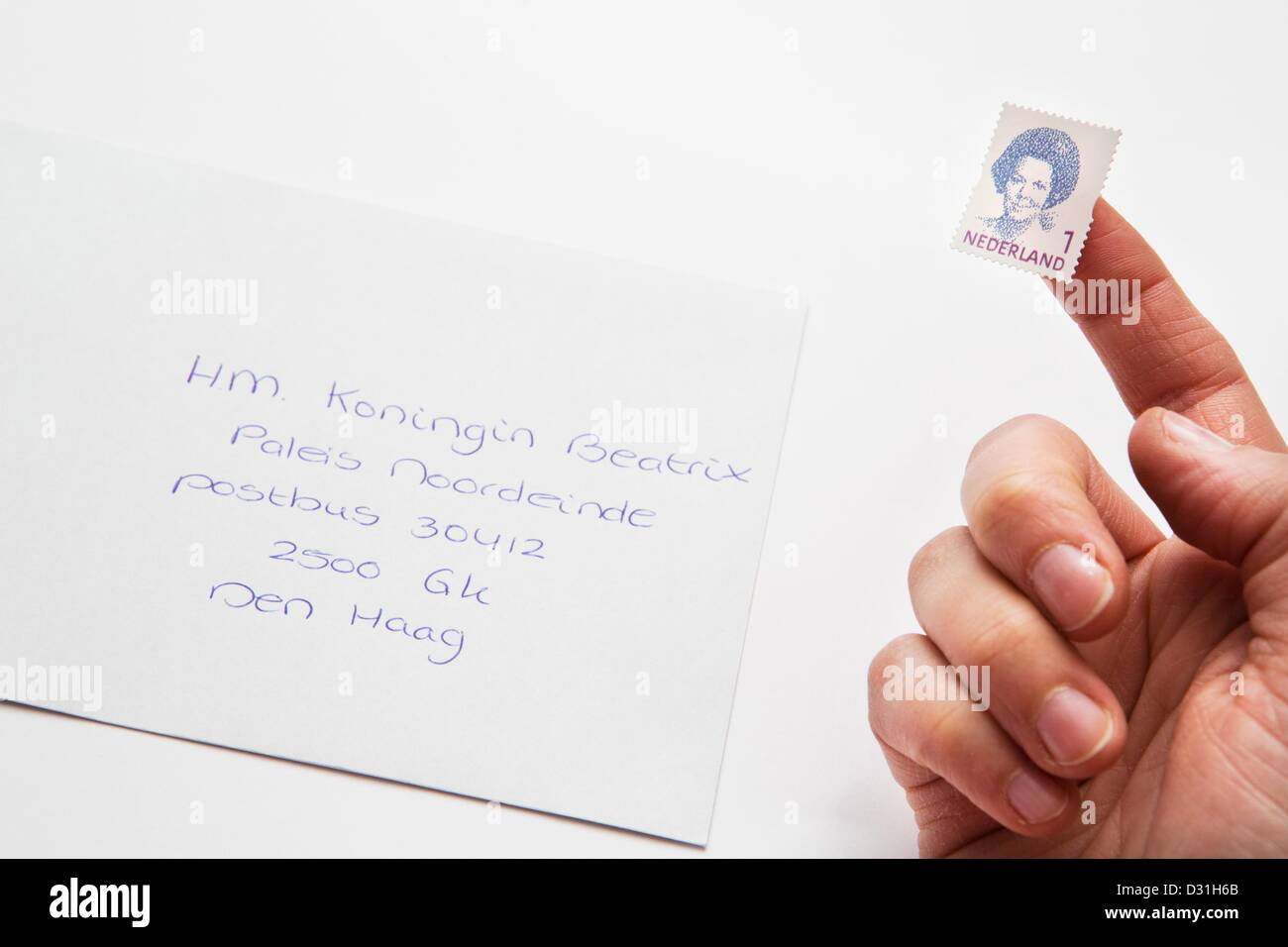 a stamp showing queen beatrix of the netherlands is attached to an envelope amsterdam 06 february 2013 photo patrick van katwijk neterlands and france