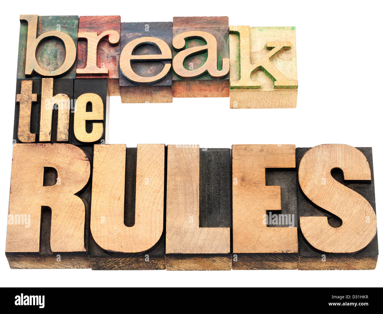 break the rules - refuse to conform - isolated text in vintage letterpress wood type printing blocks - Stock Image