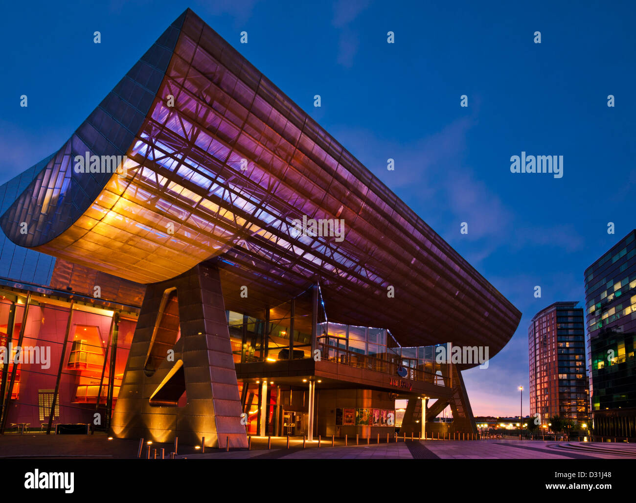 The Lowry Centre at Salford Quays illuminated at sunset Manchester Greater Manchester Lancashire England GB UK EU - Stock Image