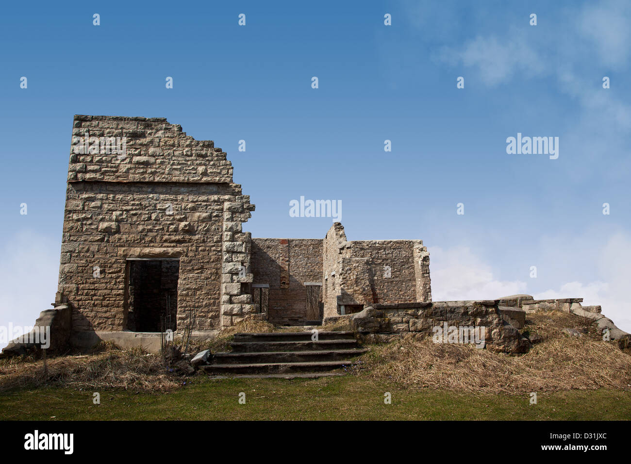 An Old Stone Mansion On A Hill Now In Ruins Shot Against Blue