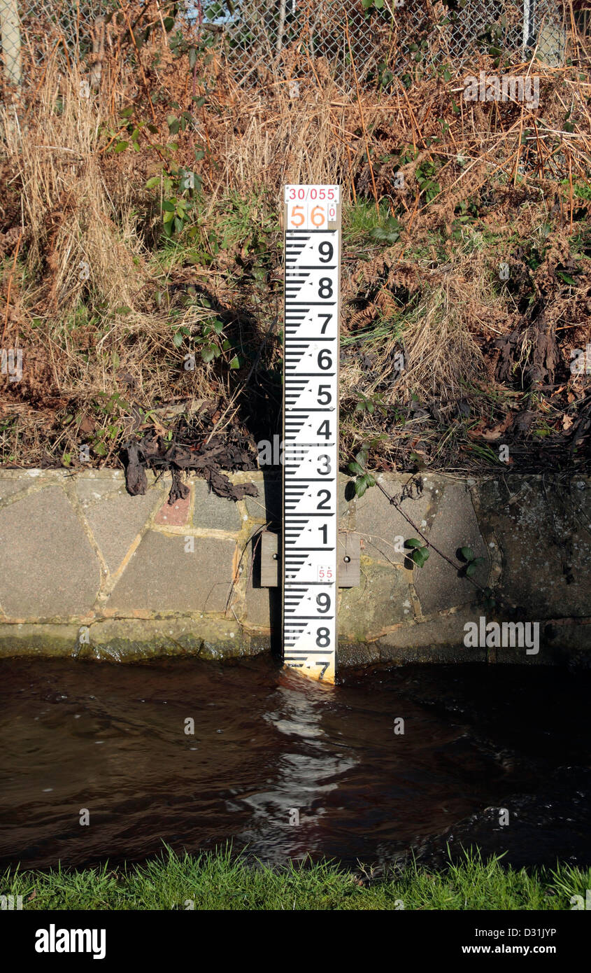 A Road Side Flood Water Marker Measuring The Depth Of A