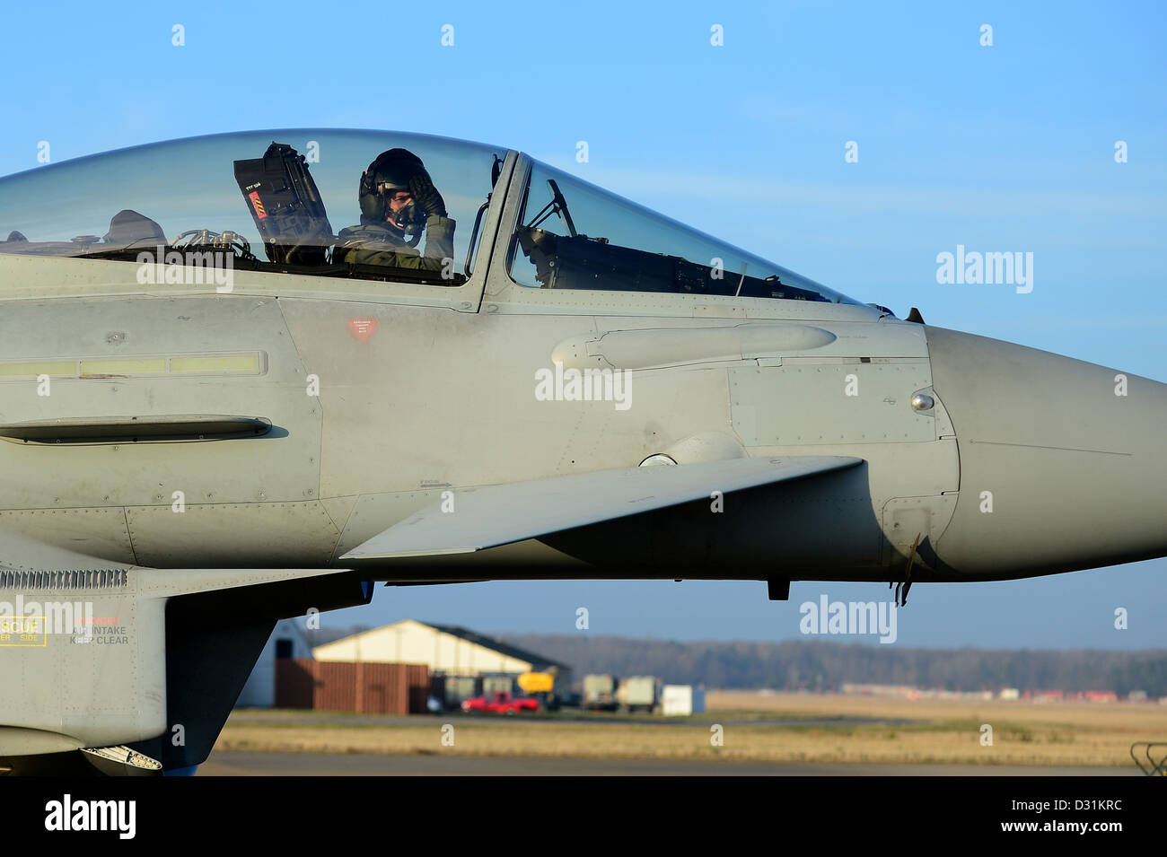 Royal Air Force Wing Cmdr. Paul Godfrey, XI Squadron Typhoon FGR4 pilot, taxis down the flight line during Exercise - Stock Image