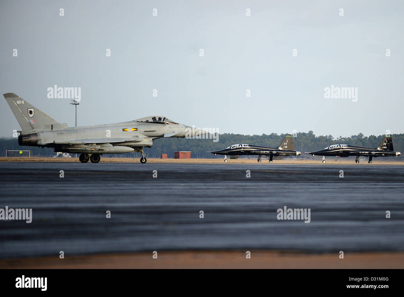 A Typhoon FGR4 taxis down the flight line as two T-38 Talons prepare to take off at Langley Air Force Base, Va., - Stock Image