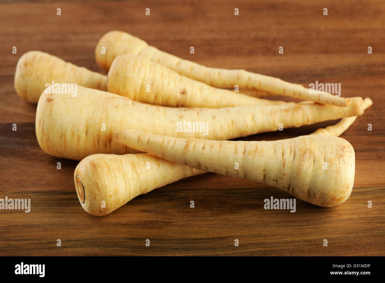 Parsnip on a wooden background, selective focus. - Stock Image