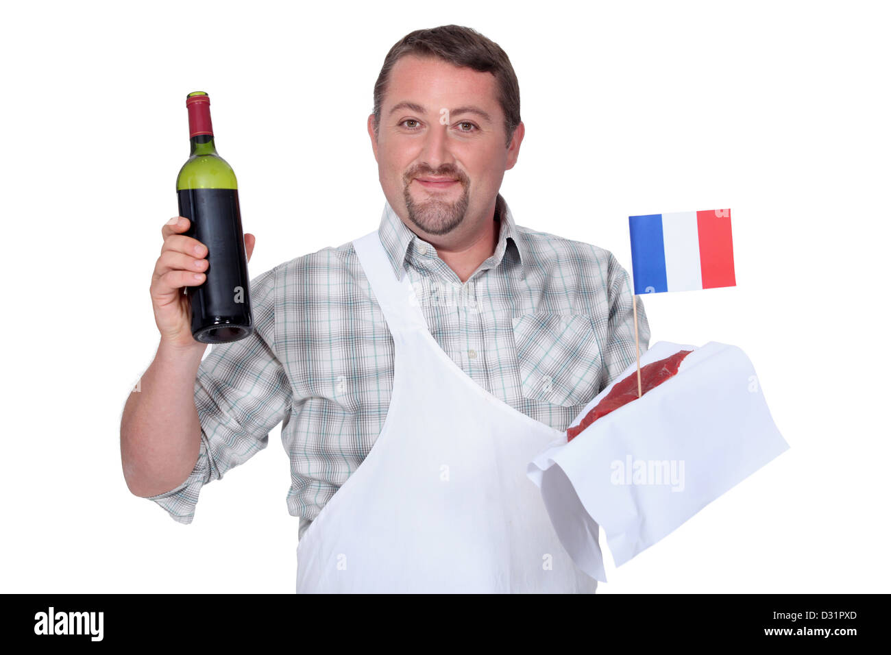 Frenchman with a bottle of red and a raw steak - Stock Image