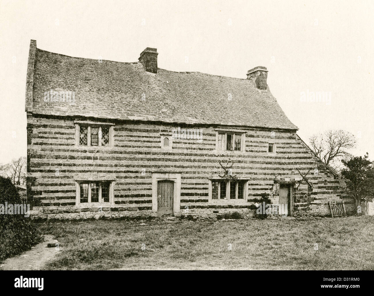A collotype plate entitled ' Cottages at Gretton, Northants.' scanned at high resolution from a book published - Stock Image