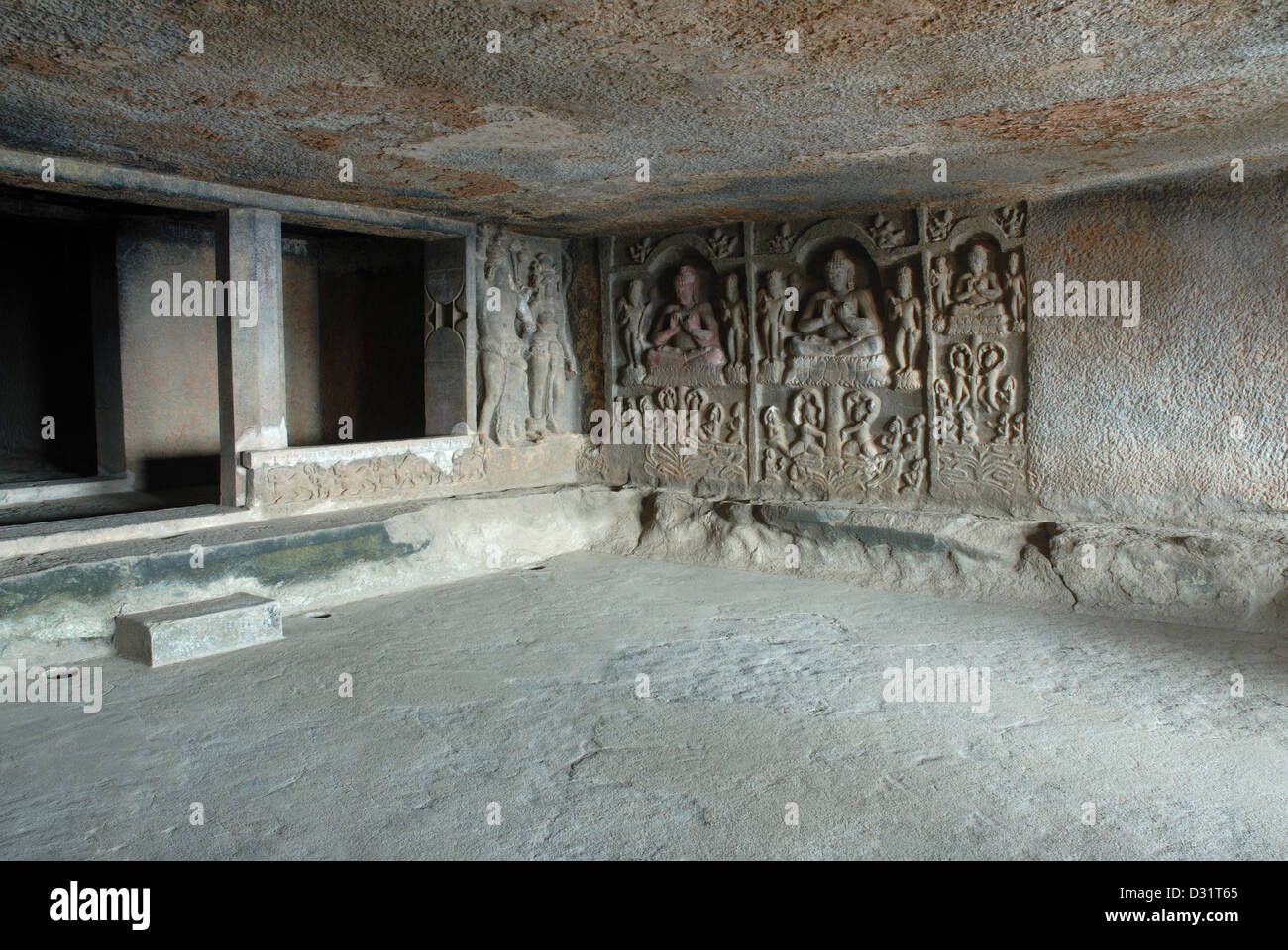 Front wall of the main hall, showing Mithuna couples on the left and right, with  stupa in the shrine. Cave 6, Kuda Stock Photo