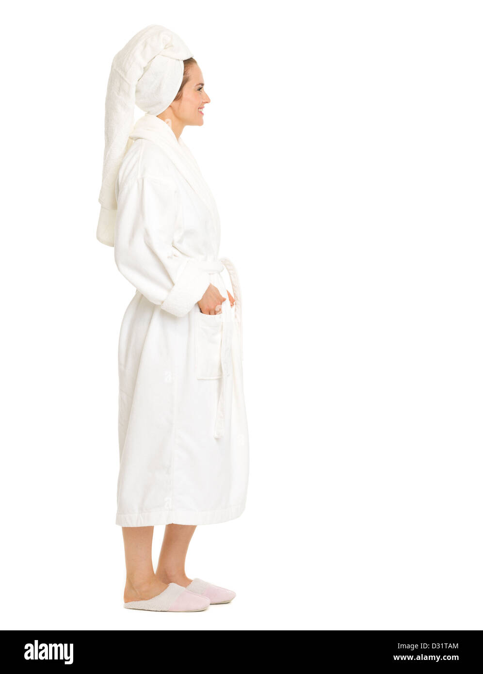 Full length portrait of young woman in bathrobe looking on copy space - Stock Image