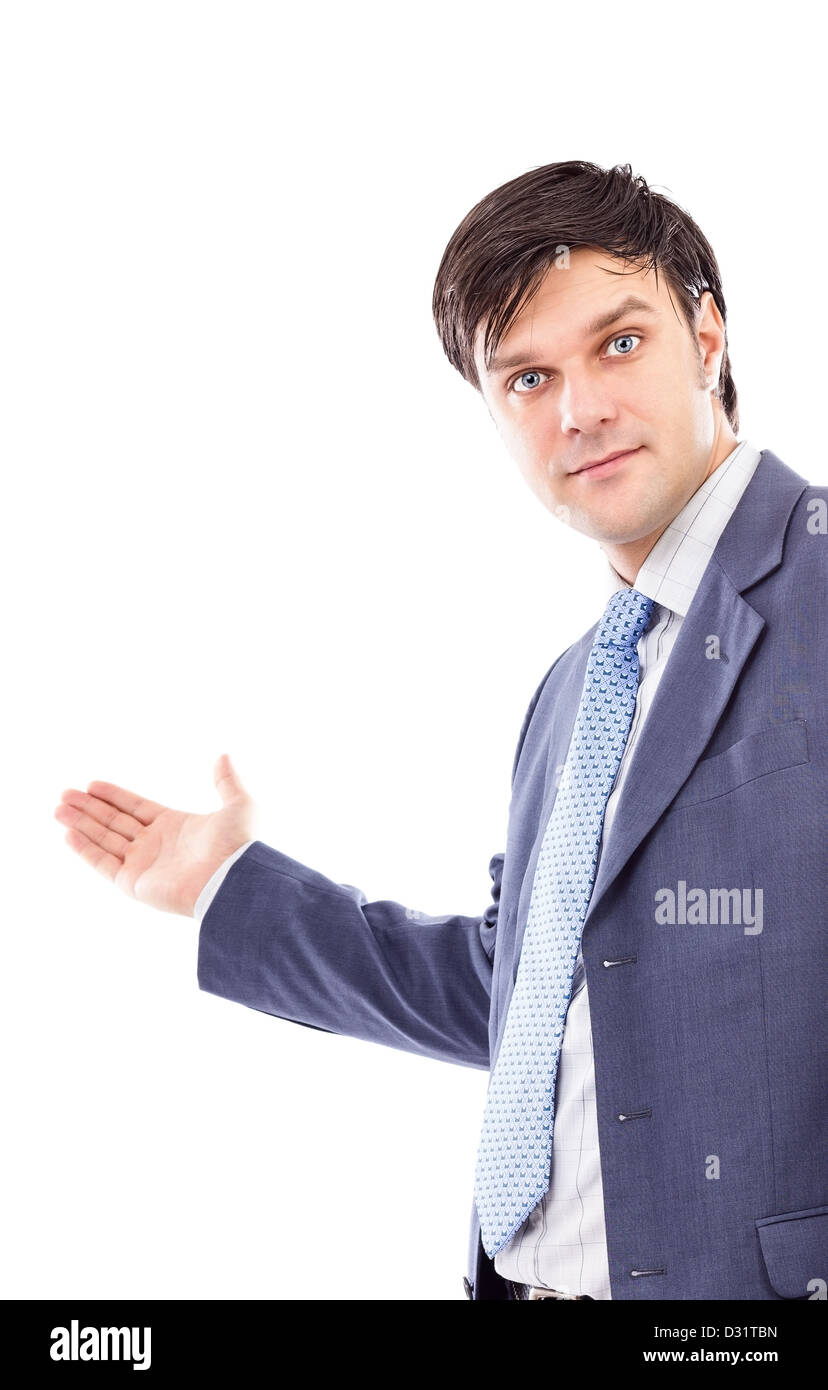 Young business man with arm out in a welcoming gesture isolated on white - Stock Image