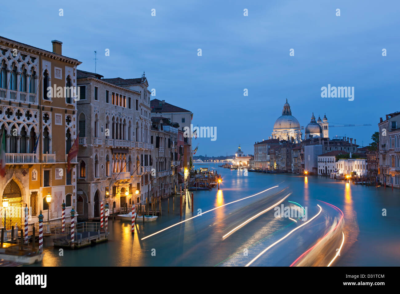 Light streaks on Grand Canal and Santa Maria della Salute Church, Venice, Italy - Stock Image