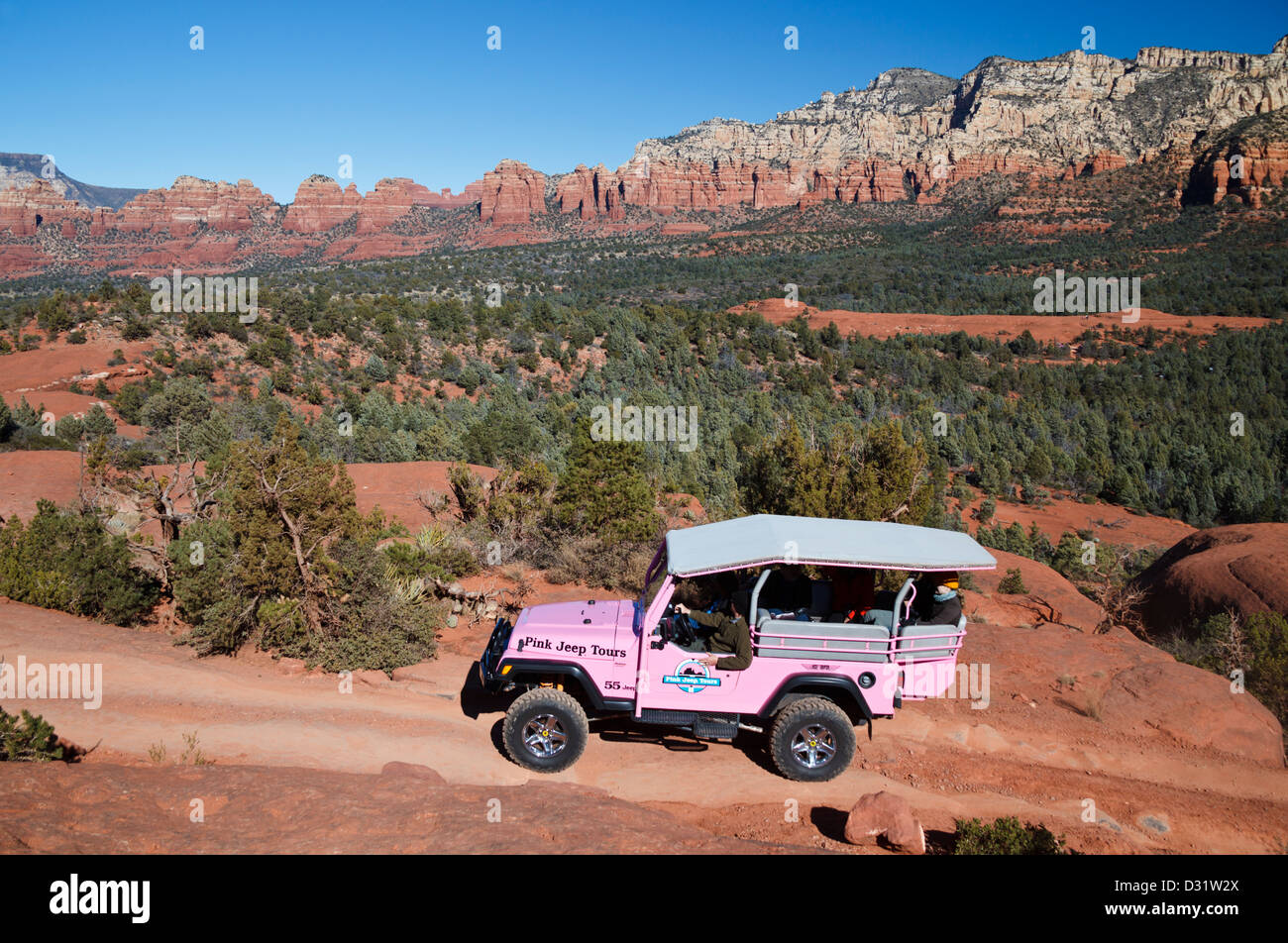 Pink Jeep Tours Explores Sedona, With Submarine Rock In Background