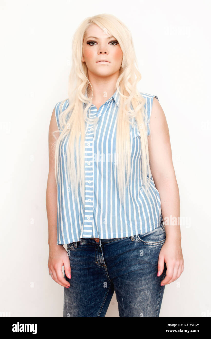 Portrait of a young blonde woman in smart casual wear. - Stock Image
