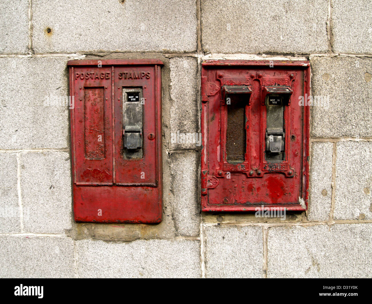 Old stamp machines and letter box's mounted on a granite wall in Aberdeen Scotland - Stock Image
