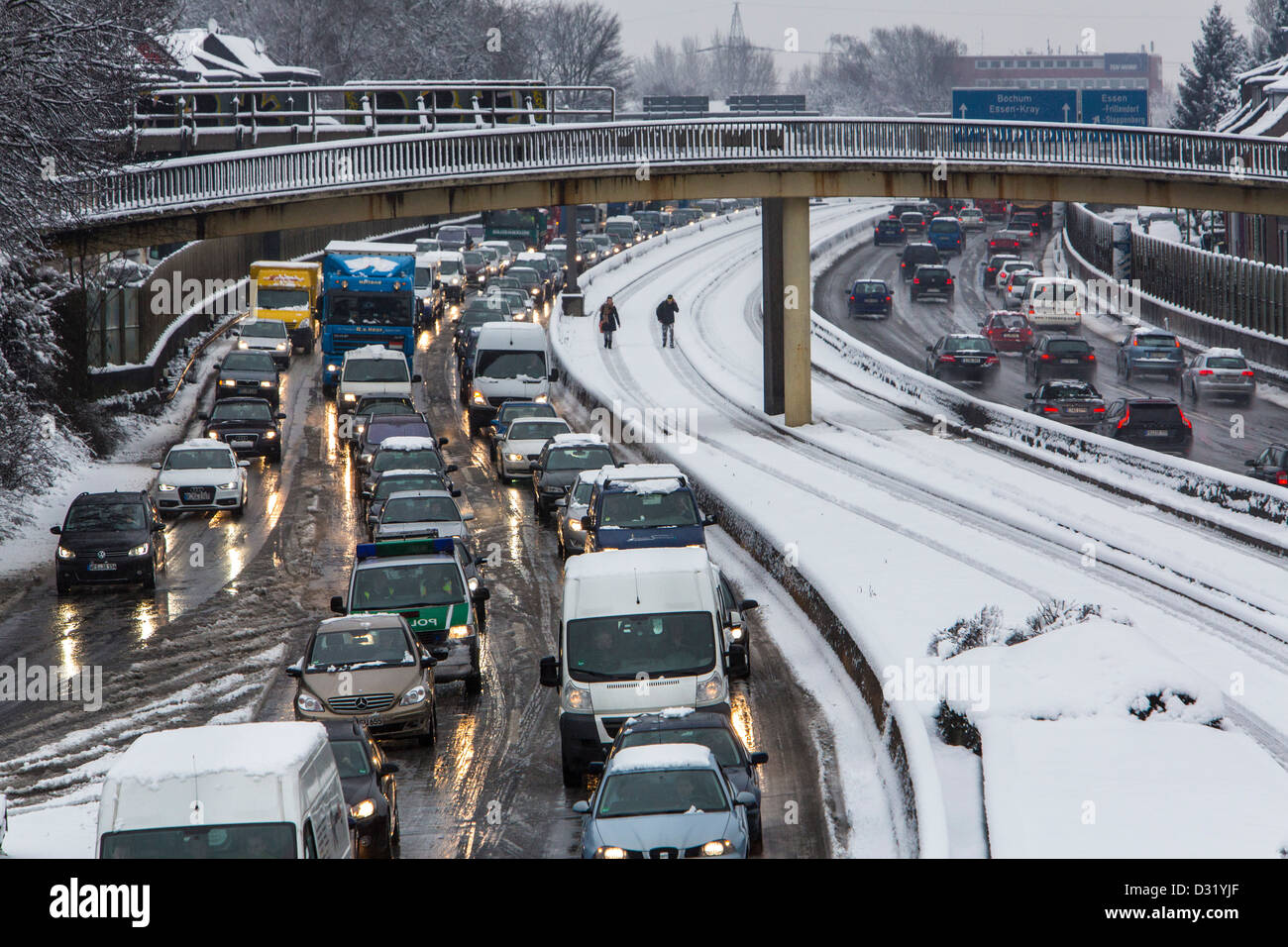 Traffic jam on German Autobahn, A40, after heavy snow fall. Hundreds of Kilometer of traffic jam during rush hour - Stock Image