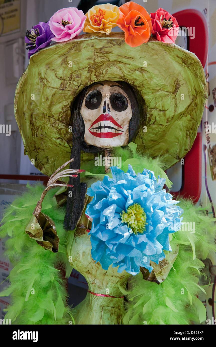 Life size papier mache skeleton wearing hat with paper flowers on life size papier mache skeleton wearing hat with paper flowers on display during day of the dead festival in oaxaca mexico mightylinksfo Choice Image