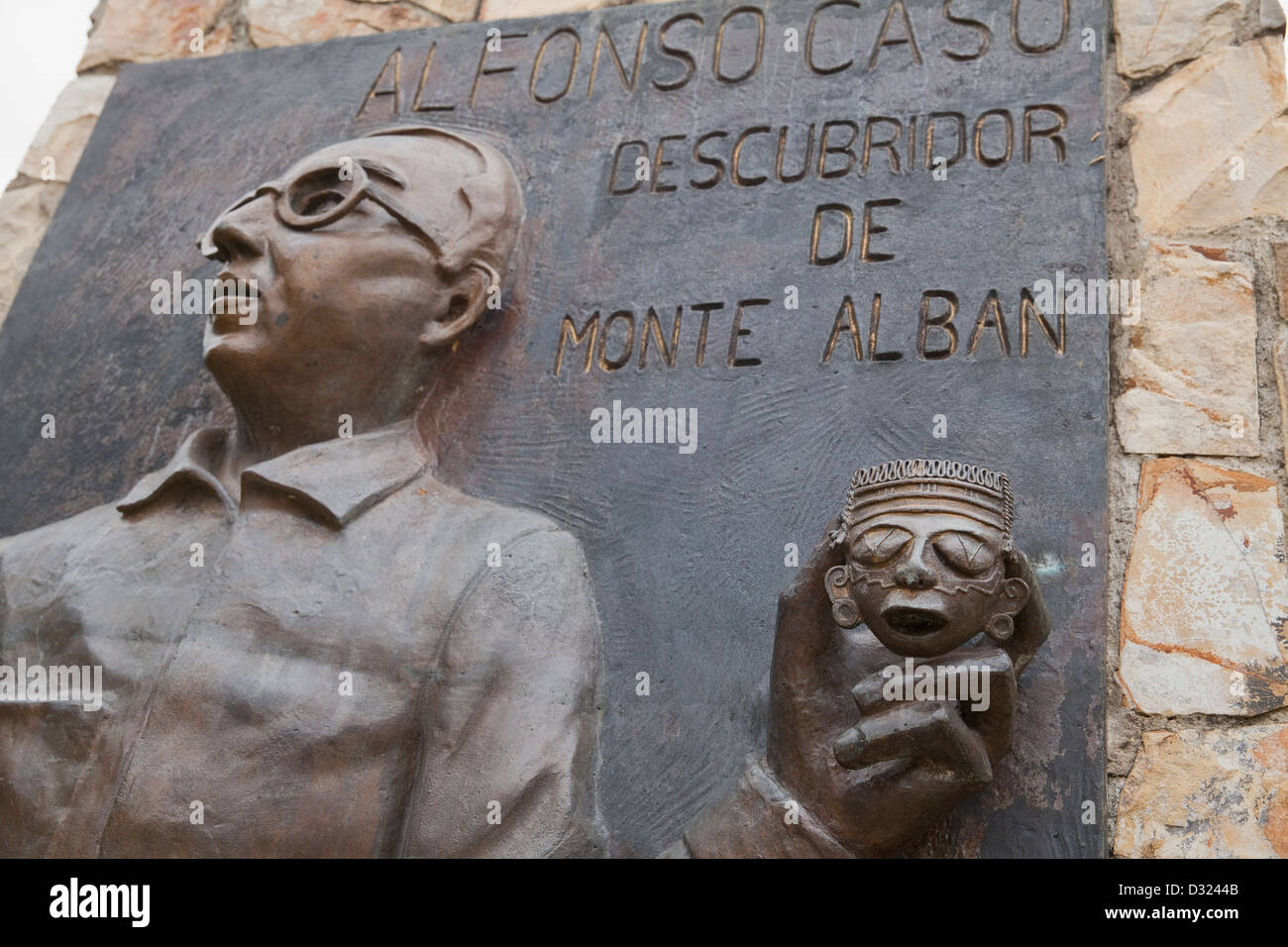 Monument showing archaeologist Alfonso Caso and gold mask, one of his most important discoveries at Monte Albán, Stock Photo