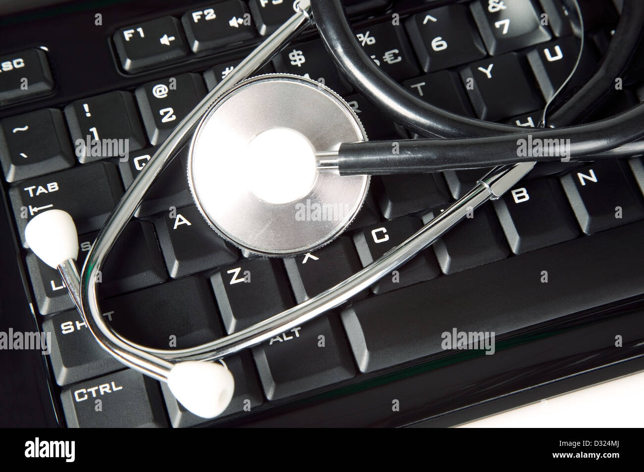 A Medicine Stethoscope Is Lying On Black Keyboard Stock Photo Electronic Auto