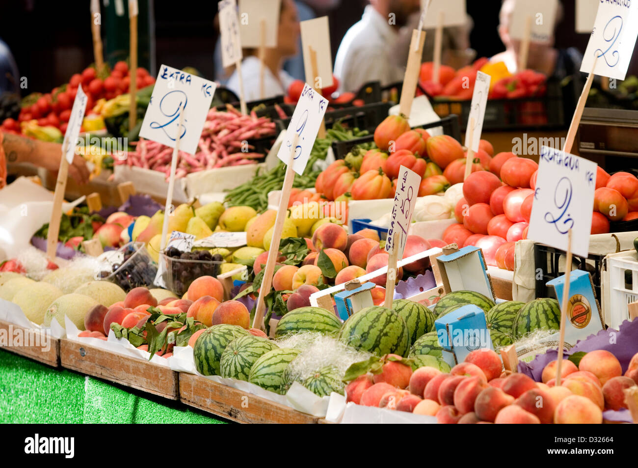 Fruit, vegetables, and customers at the Mercato di Rialto, San Polo, Venice, Italy. - Stock Image